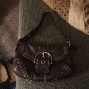 Brown leather w/ silver hardware. Great condition